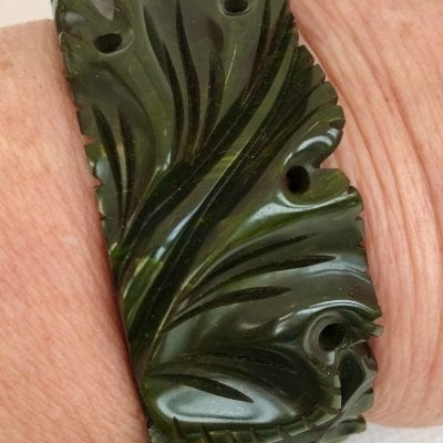 Bakelite Green Carved Clamper