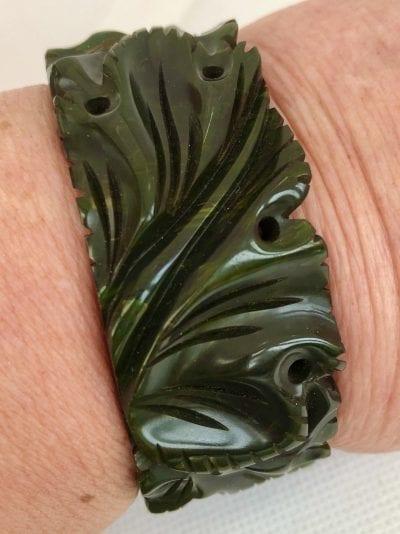 Bakelite Green Carved Clamper